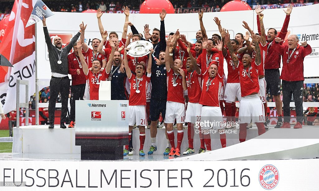 Philip Lahm lifting 2016 Bundesliga cup winners trophy