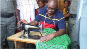 Gov Ayo Fayose on the sewing machine