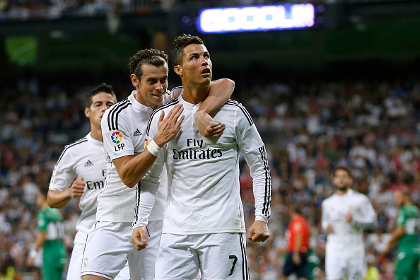 Cristiano Ronaldo (R) of Real Madrid celebrates with his teammate Gareth Bal