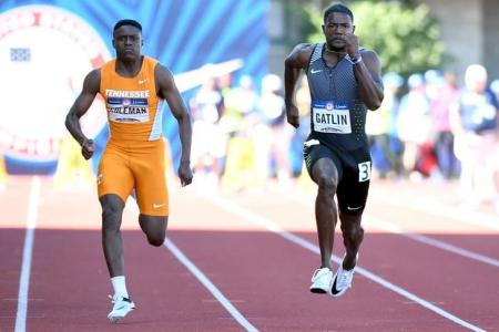 Christian Coleman (left) and Justin Gatlin (right) compete during the men's 100m semifinals