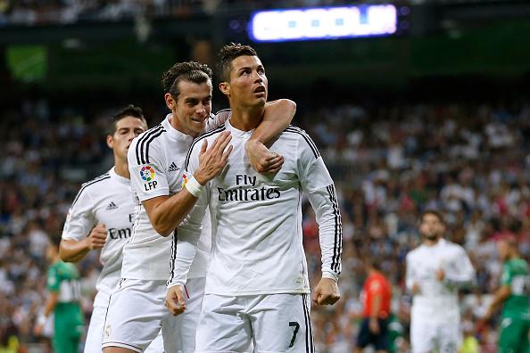 Cristiano Ronaldo (R) of Real Madrid celebrates with his teammate Gareth Bal