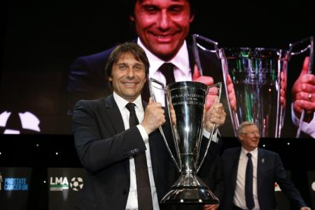 Chelsea manager Antonio Conte poses with the Sir Alex Ferguson Trophy for the LMA Manager of the Year. Mandatory