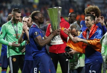 Manchester United Henrikh Mkhitaryan and Paul Pogba celebrate with the trophy after winning the Europa League.