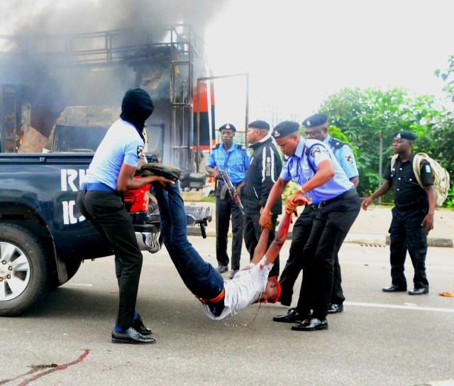 Buhari, Police, Abuja, Youths, Laptops